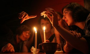Young women examine melted wax during a Russian Orthodox Christmas-tide party on the eve of Epiphany in B2 club in Moscow on Jan. 18. On winter nights set aside for fortune telling, young Russian women drip hot wax, throw shoes out of the window and crumple newspapers, hoping to get a hint about their future future husbands and careers.